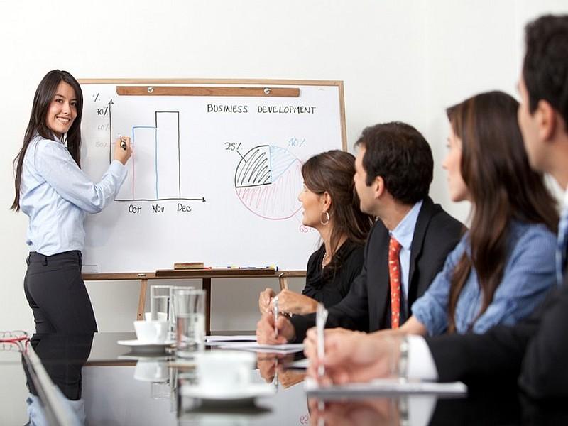 Pretty woman giving an English business presentation